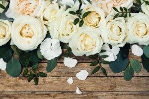 Flower arrangement on wooden background