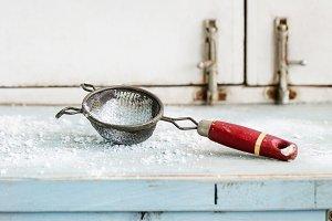 Sugar powder in vintage sieve
