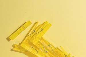 Clothes pegs on paper