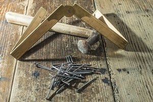 Vintage hammer, nails and wooden cen