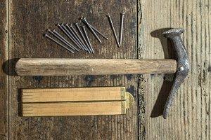 Vintage hammer, nails and wooden cen
