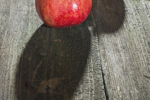 Pomegranate on wooden table
