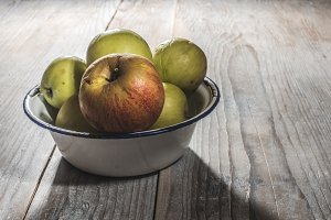 Apples in vintage metal cup