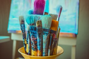 Paint brushes in a jar