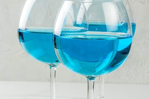 Glasses with trendy blue wine