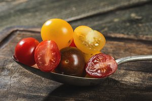 Variety of cherry tomatoes in spoon