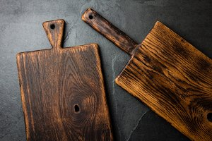 Cooking background. Vintage cutting boards copy space