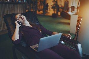 Businesswoman on massaging chair