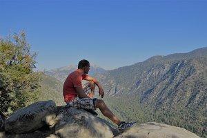 Man sits on mountain