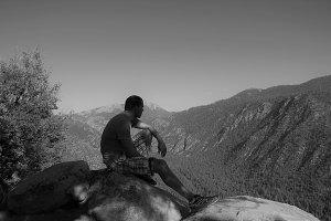 Man sits on mountain (b&w)