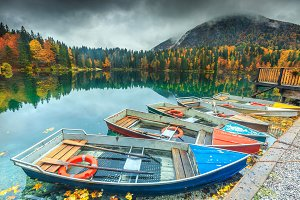 Autumn landscape with colorful boats