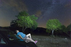 Woman lying on top of a night