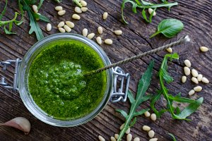 Homemade arugula pesto in a glass jar