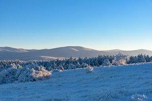 Sunset rays fall on frozen mountain
