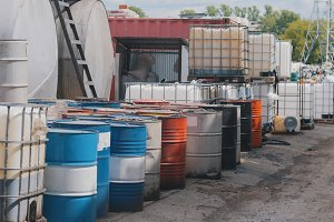 Barrels stand with waste oil and oil products