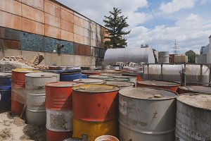 Barrels stand with spent oil products