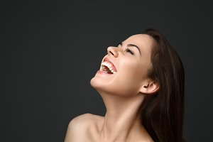 portrait of a beautiful brunette woman laughing