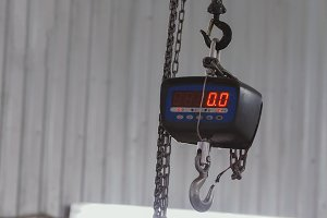 Industrial scales under ceiling in warehouse
