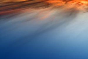 Horizontal vivid sunset altitude cloudscape background backdrop
