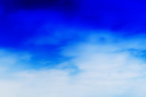 Horizontal vivid blue sky clouds in motion background backdrop