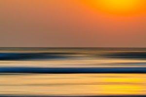 Vertical vivid orange motion blur ocean landscape abstraction ba