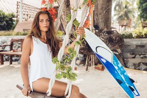 Beautiful woman with surf on beach.