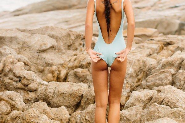 Beautiful girl walk at stone beach.