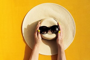 Straw Hat with Sunglasses on Yellow