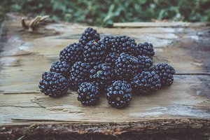 Blackberries on wooden background