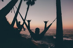 People in hammocks by the beach