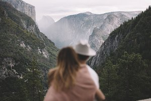 Hipster couple looking at mountains