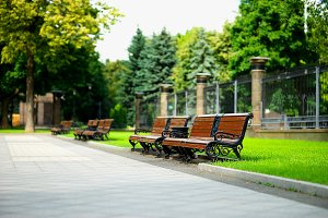 Horizontal city park benches background