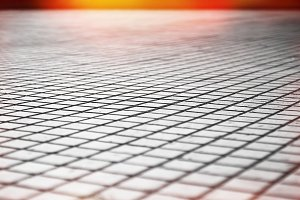 Street bricks pavement texture with light leak background