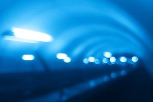 Diagonal futuristic blue metro bokeh background