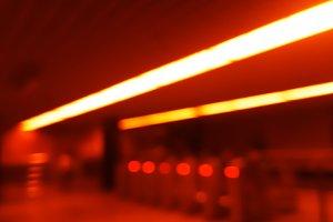 Diagonal orange lights in metro bokeh background