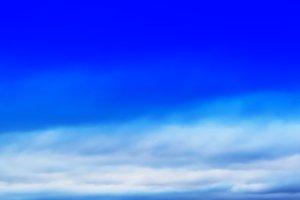 HORIZONTAL VIVID BLUE CLOUDSCAPE DRAMATIC BOTTM ALIGNED CLOUDS B