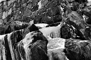 Vertical vibrant black and white frozen waterfall bokeh composit