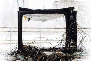 Horizontal vintage broken tvset in radioactive pripyat bokeh bac