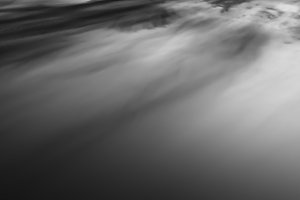 Horizontal black and white sunset altitude cloudscape background