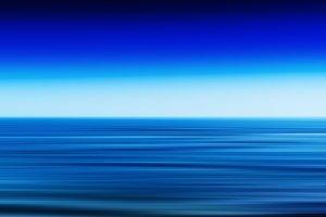 Horizontal vivid vibrant fresh blue ocean landscape motion blur