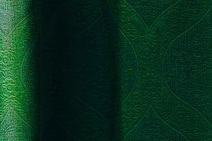 Vertical vivid vibrant green curtain drapery background backdrop