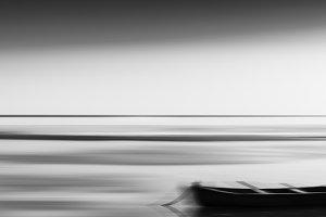 Horizontal vivid vibrant black and white travel boat blur abstra