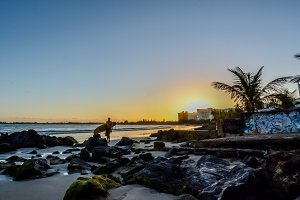 Surfer and a Caribbean Sunrise