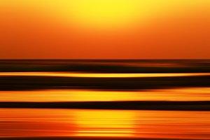 Horizontal vivid orange golden Indian ocean sunset motion abstra
