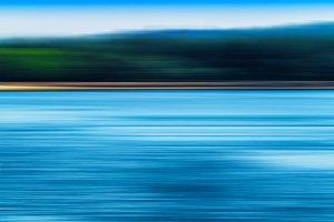 Horizontal vivid blur ocean horizon land landscape background ba