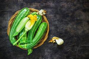 Fresh zucchini on the dark background
