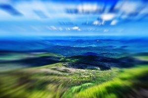 Horizontal vivid bokeh zoom landscape abstraction