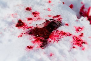 Horizontal vivid red jam on snow background backdrop