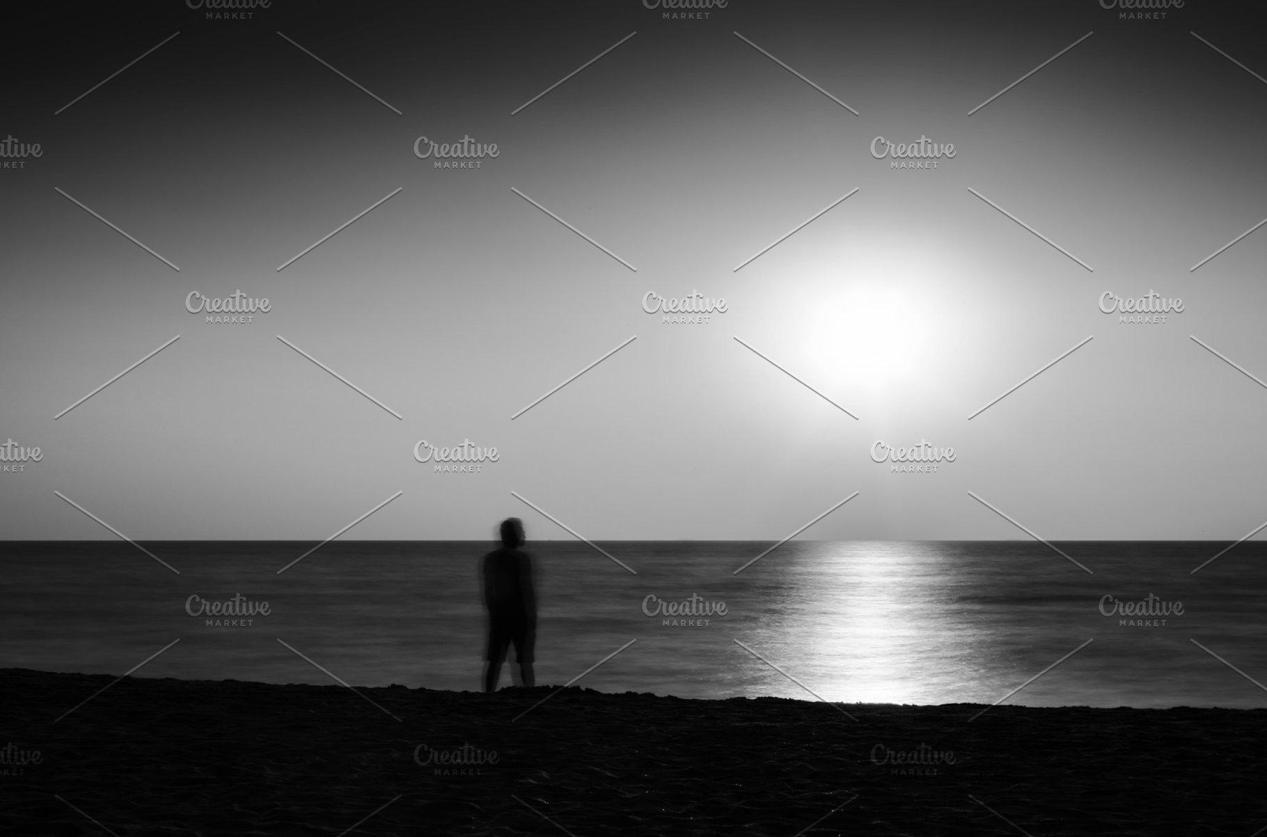 Horizontal vivid black and white meeting ocean sunset lonely man
