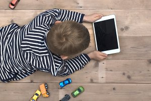young kid using tablet pc